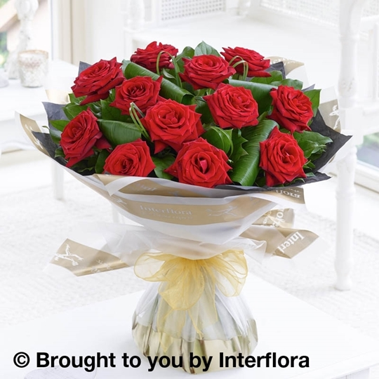 Picture of luxury 12 Long Stem red Roses Hand-tied