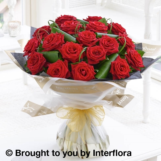 Picture of luxury 18 Long Stem red Roses Hand-tied