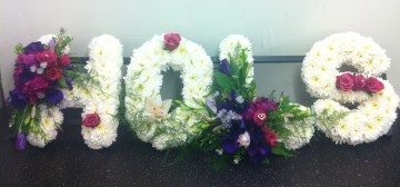 Custom Name Funeral Tribute With Cerise & Purple Sprays
