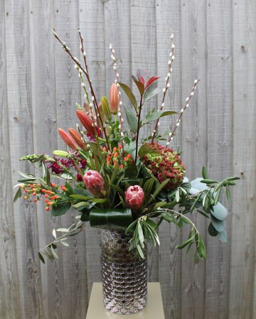 Vase Display Of Hydrangea, Protea, Lily, Willow And Foliage