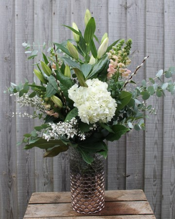 Vase Display Of Ivory Hydrangea, lily, Antirrhinum With Foliage