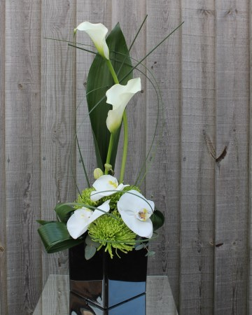 Black Cub Vase Display Calla Lily, Phalaenopsis And Chrysanthemum Blooms