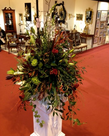 Pedestal Display In Reds And Green At Antiques Fair National Exhibition Centre NEC