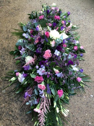 purple lilac and pink country garden casket spray