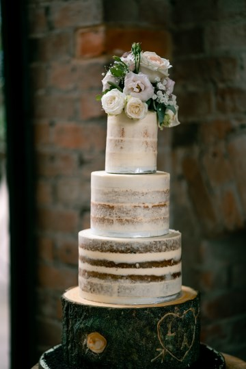 Semi Naked Cake With Top Posy Display Of flowers