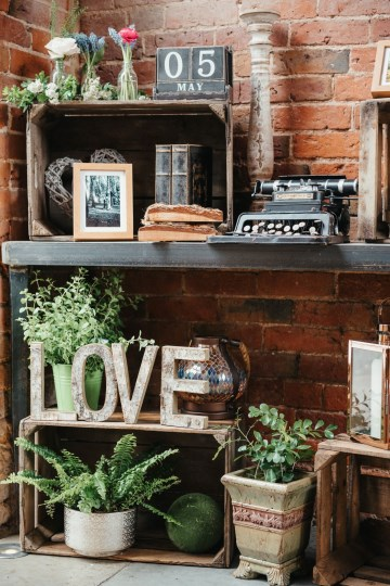Entrance table styling at shustoke farm barns - prop hire - crates - wild herbs - love letters