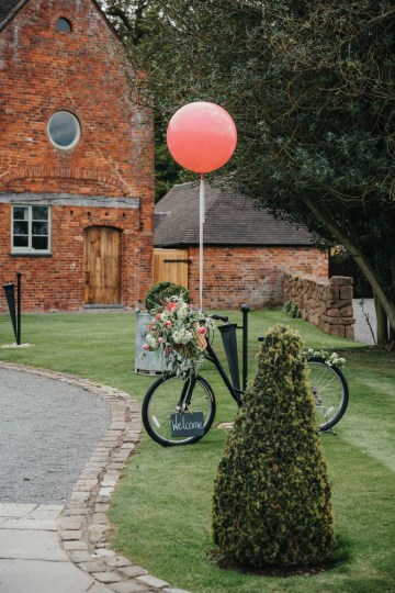Vintage Bicycle - basket of flowers- shustoke farm barns - entrance styling - welcome board