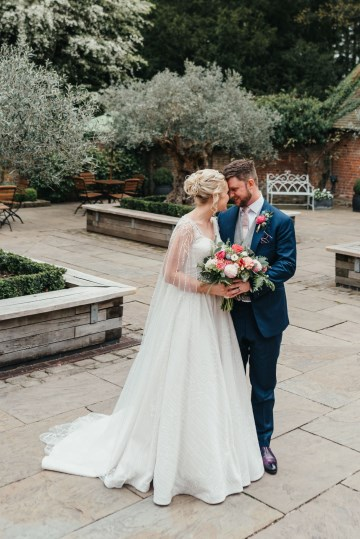 Emma and Neil in courtyard at Shustoke Farm Barns