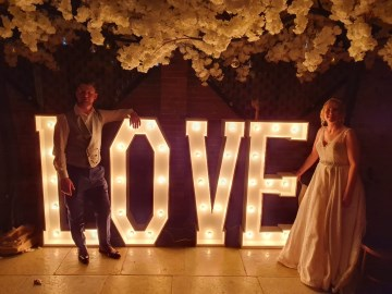 Light up LOVE letters - marquee lights - bride and groom at shustoke farm barns