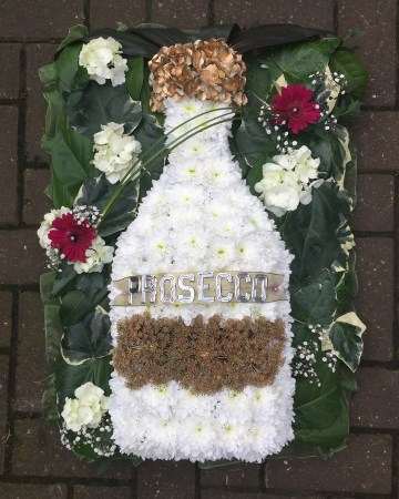 Bottle of Prosecco funeral tribute spray - funeral flowers