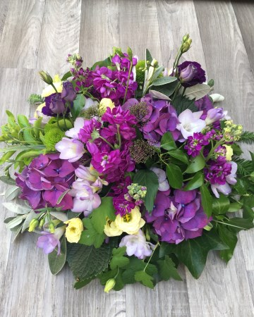 purple and lilac posy display - funeral tribute - posy design - purple and lilac flowers