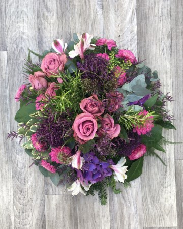 purple and pink posy display - funeral tribute posy design - pink rose purple allium - alstromeria - xanths