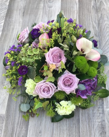 lilac and purple posy display - funeral tribute design - lilac rose - purple lisianthus - calla lily