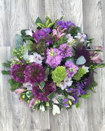 lilac and purple posy display - funeral tribute design - lilac rose - purple lisianthus - allium - freesia