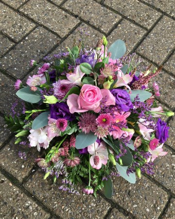 pink and purple posy display - funeral tribute design - pink roses - purple lisianthus - freesia
