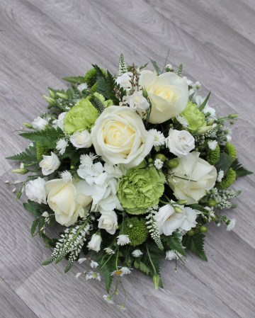 green and white posy display - funeral tribute posy design - white roses - lisianthus september - veronica - green carnation - hypericum - kermit xanth