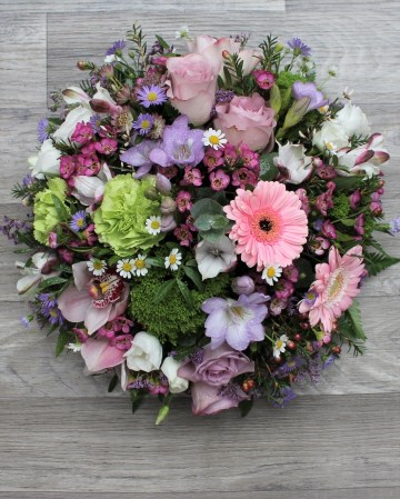 pink and lilac posy display - funeral tribute posy design - lilac rose pink germini green carnation -mixed pink lilac and green flowers