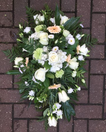 ivory and peach single ended spray funeral tribute - peach germini - ivory roses - lisianthus- hydrangea - spray cars - green carnation