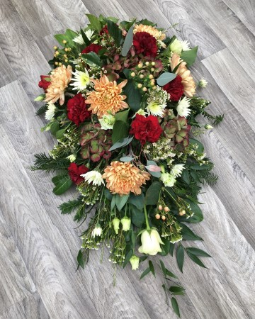 autumnal mix single ended spray - funeral tribute design - deep red - peach -ivory - carnation  xanth bloom - hypericum - hydrangea - roses - lisianthus